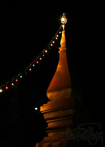 Stupa in Wat Manorum adorned for the Lao new year. Luang Prabang, Lao PDR.