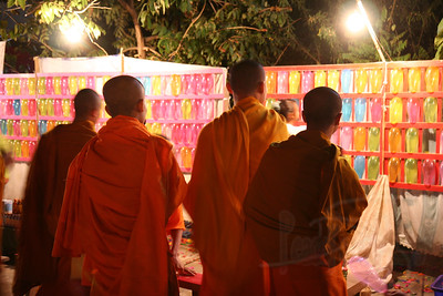 Young Buddhist monks enjoying the Lao new years festivities hosted by the temple. Luang Prabang, Laos