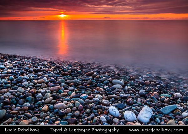 Georgia - Batumi - ბათუმი - Seaside city on the Black Sea coast & capital of Adjara (autonomous republic in southwest Georgia) - Sunset on pebbles beach of Black Sea
