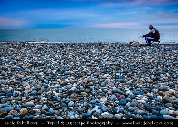 Georgia - Batumi - ბათუმი - Seaside city on the Black Sea coast & capital of Adjara (autonomous republic in southwest Georgia) - Fisherman fishing on the shores of sea resort pebble beach