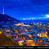 Georgia - Tbilisi - თბილისი - Capital City Skyline from Narikala - Narikhala Castle with view at Mt'k'vari River that seperates the old city and new part of Tbilisi during Dusk - Twilight - Blue Hour - Night