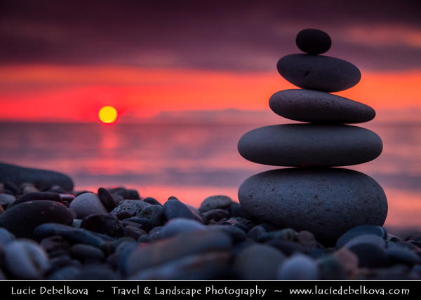 Georgia - Batumi - ბათუმი - Seaside city on the Black Sea coast & capital of Adjara (autonomous republic in southwest Georgia) - Pebbles Zen Towers on the Black Sea beach at Sunset
