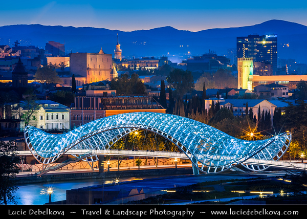 Georgia - Tbilisi - თბილისი - Capital City Skyline & The Bridge of Peace - Tbilisi's ultra-modern pedestrian walkway - Fascinating structure of glass and iron - Connects the ancient city of Tbilisi across the Mt'k'vari River - Night View