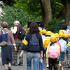 Kids with yellow hats leaving the Tokyo Zoo.