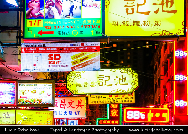 Asia - Hong Kong - 香港 - Special administrative regions (SARs) of the People's Republic of China - Kowloon - Busy street life with many shops, neon lights, people, cars, buses on Nathan Road at night