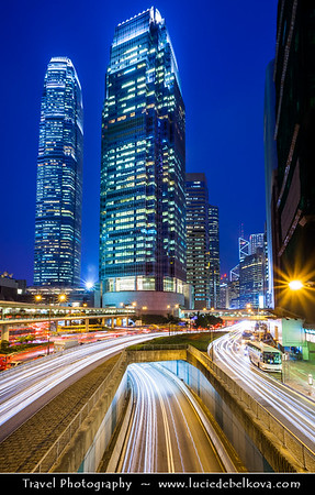 Asia - Hong Kong - 香港 - Special administrative regions (SARs) of the People's Republic of China - View of high rise buildings & skyscrapers with busy traffic on the road in Central district of Hong Kong Island - Dusk - Twilight - Blue Hour
