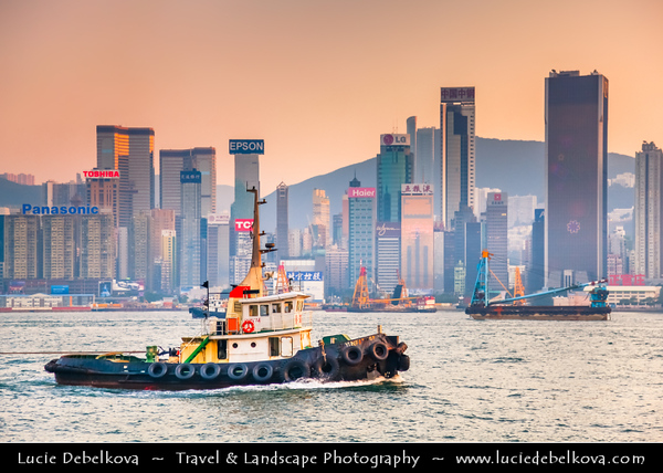 Asia - Hong Kong - 香港 - Special administrative regions (SARs) of the People's Republic of China - View of high rise buildings, skyscrapers on the city skyline of Victoria Harbour in Central district of Hong Kong Island - Sunset