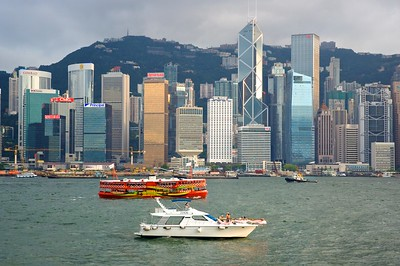 Hong Kong Harbor. The boat in the lower center has a couple taking wedding photos.