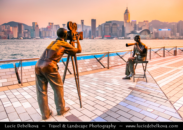 Asia - Hong Kong - 香港 - Special administrative regions (SARs) of the People's Republic of China - View of high rise buildings, skyscrapers on the city skyline of Victoria Harbour in Central district of Hong Kong Island & Statues on the Avenue of Stars waterfront promenade during Sunset