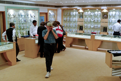 In the jewelry store - Abe ponders the purchase being made in the background