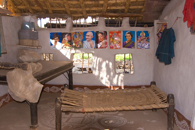 The interior of the hut was decorated with pictures of gods, politicians, national heroes, and bollywood stars. The bed in the forground a common type taht we saw in many places