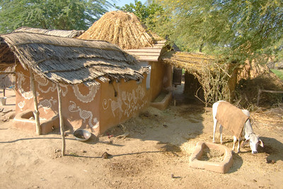 The huts were made of mud and straw. There was nothing around that appeared to be technology less than 5000 years old. We did see TV sets in other settlements - but not in this one