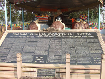 Buddha's first sermon is displayed on plaques in several languages