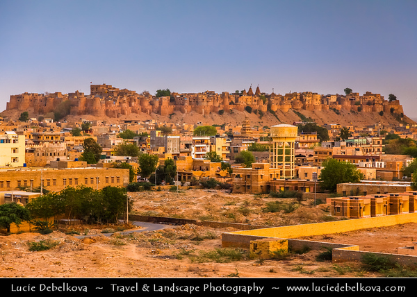 "India - Rajasthan - Jaisalmer - ""Golden City of India"" - UNESCO World Heritage Site - Former medieval trading center in heart of Thar Desert, distinguished by its yellow sandstone architecture & Jaisalmer Fort dominating skyline - Sprawling hilltop citadel buttressed by 99 bastion"