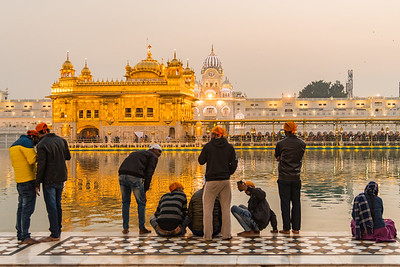 January 2018 - A group of young men take in the sights of the Golden Temple - in Amritsar, India.