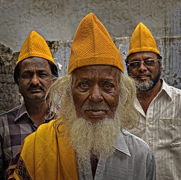 Three Men with Yellow Caps