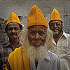 Three Men with Yellow Caps