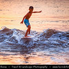 Indonesia - Bali Island - Local Boys Surfing at the Sunset at Jimbaran Beach - Located on Bali's west coast - Jimbaran offers a small secluded beach area, where tranquility and peace are the perfect antidote to a stressful world