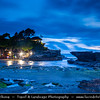 Indonesia - Bali Island - Dusk at Tanah Lot Temple - Bali's Cultural Icon - Located in Tabanan, about 20 km from Denpasar, the temple sits on a large offshore rock which has been shaped continuously over the years by the ocean tide
