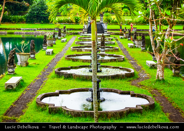 Indonesia - Bali Island - Tirtagangga - Meaning holy water of the Ganges in Balinese - One of the world's romantic gardens out of time. Gushing springs flowing from beneath an ancient Banyan tree and holy temple fill the myriad reflecting and swimming pools that grace the Water Palace