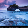 Indonesia - Bali Island - Dusk at Pura Batu Bolong - Small shrine located just a stone's throw from the famous Tanah Lot temple perched at the end of a rocky promontory that leaps seaward into the surging Indian Ocean