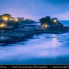 Indonesia - Bali Island - Dusk at Tanah Lot temple perched at the end of a rocky promontory that leaps seaward into the surging Indian Ocean