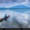 Indonesia - Bali Island - Lake Batur under the shadow of the magnificent active volcano Mt Batur - Active volcano located at the center of two concentric calderas north west of Mount Agung