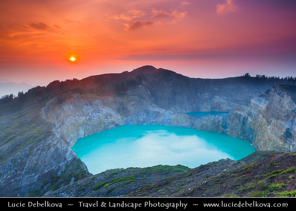 Indonesia - Flores Island - Sunrise over Kelimutu The Three Colors Lake - Known for its three colors, namely red, blue and white. Even so, the colors are always changing with the passage of time. Colors of the three lakes that are black, turquise blue and the other is green