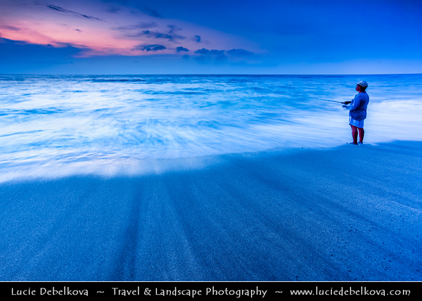 Indonesia - Lombok Island - Lonely Fisherman at Beautiful Senggigi beach at Sunset