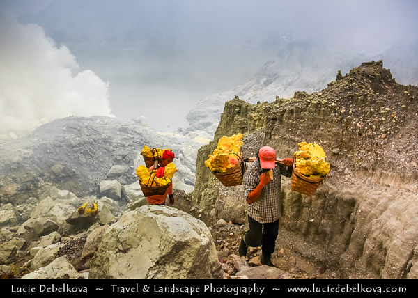 Indonesia - Java Island - Local Men Working in Sulphur Mines at Ijen Volcano - The Ijen volcano complex is a group of stratovolcanoes in East Java - It is inside a larger caldera Ijen, which is about 20 kilometers wide