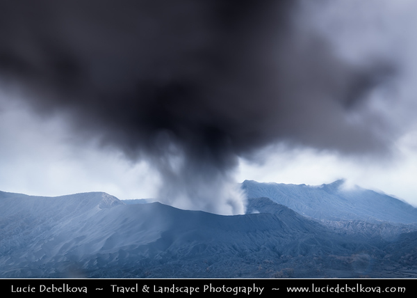 Indonesia - Java Island - Bromo-Tengger-Semeru National Park - Active Mount Bromo (2,329 m) - Volcano with the entire top been blown off and the crater inside constantly belches white sulphurous smoke. It sits inside the massive Tengger caldera (diameter approximately 10 km), surrounded by the Laut Pasir (Sea of Sand) of fine volcanic sand