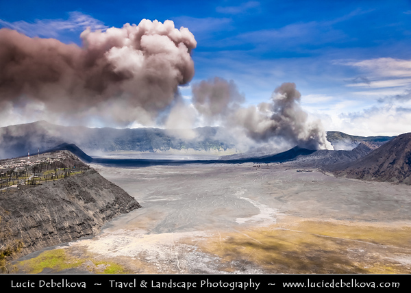 Indonesia - Java Island - Large Volcanic Ash Cloud over Bromo-Tengger-Semeru National Park - Active Mount Bromo (2,329 m) - Volcano with the entire top been blown off and the crater inside constantly belches white sulphurous smoke. It sits inside the massive Tengger caldera (diameter approximately 10 km), surrounded by the Laut Pasir (Sea of Sand) of fine volcanic sand