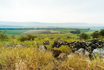 Hula valley from the Golan Heights. Remains of a Syrian village hut  in the foreground