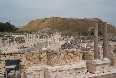 Cardo of Beit Shean with the Tel in the background. The Tel has 15 layers of cities