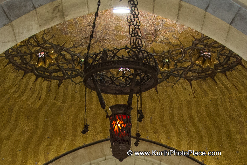The Dome of the Church of Flagellation is circled by a crown of thorns.  The crown contains stars.  The eternal light is also in this shot.  Notice the whips attached to it.