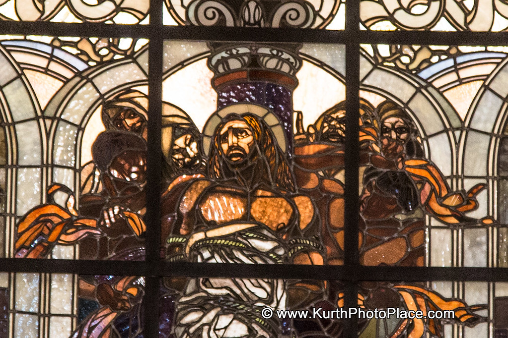 This stained glass window detail  is above the alter.  It shows Jesus being whipped.