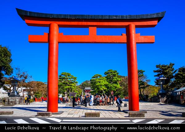 Japan - Honshu Island - Kanagawa Prefecture - Kamakura - 鎌倉市 - Kamakura-shi - Tsurugaoka Hachiman-gū - The most important Shinto shrine in the city of Kamakura - Traditional red colored Torii at entrance to shrine