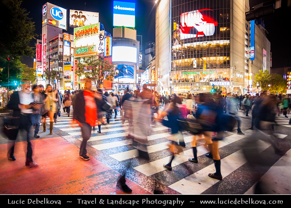 Japan - Honshu Island - Tokyo - 東京 - Tōkyō - Shibuya - 渋谷 - Shibuya's famous crossing - Craziest spot on Earth & world's busiest street crossing - Scramble crossing - entire intersection opens up for pedestrians to cross & traffic comes to a complete halt - thousands of people cross within minutes, all day, everyday - morning, noon & night