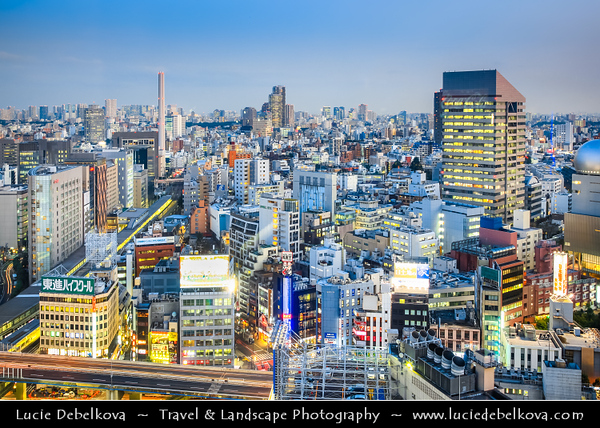 Japan - Honshu Island - Tokyo - 東京 - Tōkyō - Shibuya - 渋谷 - Shopping district which surrounds Shibuya Station, one of Tokyo's busiest railway stations - Cityscape view over the modern part of Tokyo at Dusk