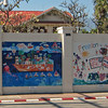 The walls of the US Embassy are covered with patriotic painting done by school children.