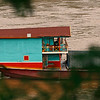 A commercial boat that transports rice on the Mekong, it has a nice cabin for the family of the crew to live in during the several day journey.