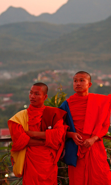 Two monks from Thailand being tourists in Laos