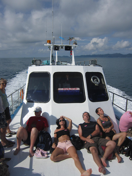 Travelers find seats or places to strech out on the crowded boat