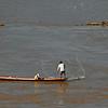 Fishermen casts a net