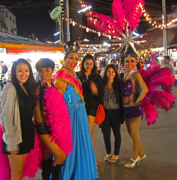 Thailand has a very tolerant society and these transvestites circulate with the tourists advertising dance contests.
