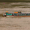 This is the main passenger boat heading up river on the Mekong.