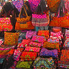 These brightly colored embrodiered bags are very popular. Originaly from southern China they are now manufactured locally for tourist sale.