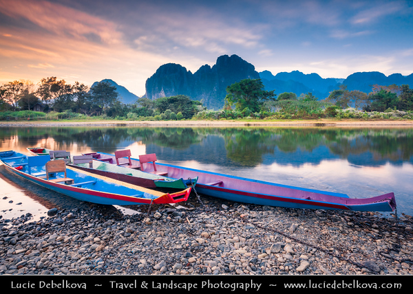 Asia - Laos - Vientiane Province - Vang Vieng - Small traditional town surrounded by Limestone Hills - Nam Song River with long tail boats