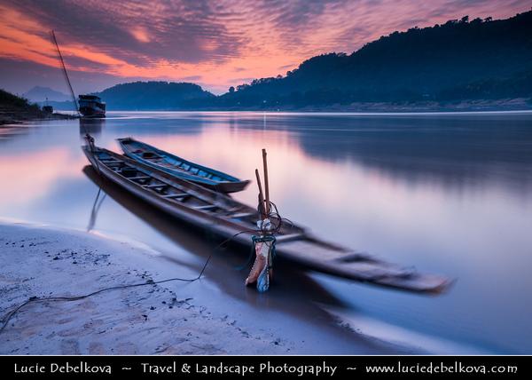 Asia - Laos - Luang Prabang - Louangphrabang - UNESCO World Heritage Site - Ancient royal capital at confluence of Mekong River & Nam Khan river - Traditional life along the Mekong River full of  long tail boats - Sunset