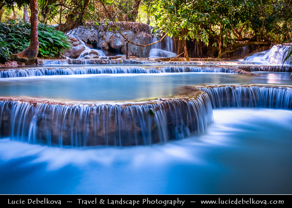 Asia - Laos - Luang Prabang Province - Tat Kuang Si Waterfall situated approximately 30 km south of Luang Prabang - Picturesque waterfalls in the region with multi-tiered cascades in area of a limestone cliff backdrop